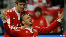 Munich's Martin Demichelis, right, and his teammate Thomas Mueller, left, celebrate after the first goal for Munich during the German first division Bundesliga soccer match between FC Bayern Munich and 1899 Hoffenheim in the stadium in Munich, southern Germany, on Friday, Jan. 15, 2010. (dapd Photo/Stringer) ** NO MOBILE USE UNTIL 2 HOURS AFTER THE MATCH, WEBSITE USERS ARE OBLIGED TO COMPLY WITH DFL-RESTRICTIONS, SEE INSTRUCTIONS FOR DETAILS ***