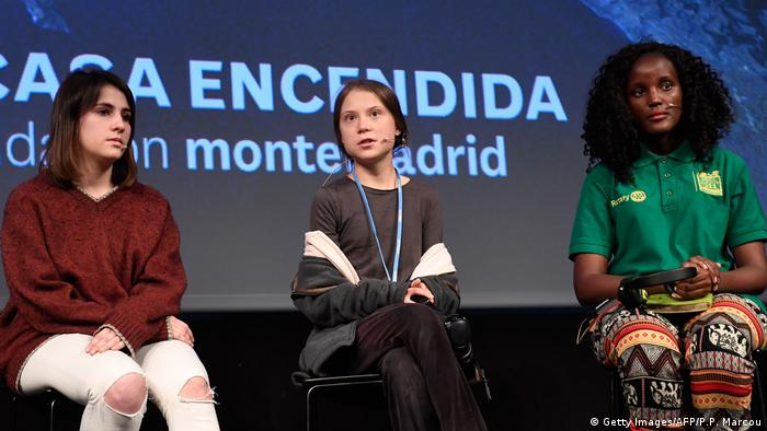 Vanessa Nakate with fellow Fridays For Future activists Shari Crespi of Spain (left) and Greta Thunberg (center) at a press conference during the COP25 summit in Madrid in 2019
