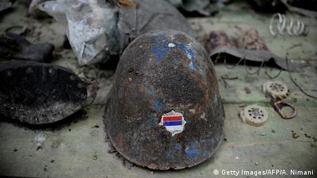An old helmet with Serbian flag found in Kosovo (Getty Images/AFP/A. Nimani)