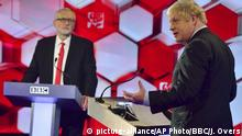 Opposition Labour Party leader Jeremy Corbyn, left, and Britain's Prime Minister Boris Johnson, during a head to head live Election Debate at the BBC TV studios in Maidstone, England, Friday Dec. 6, 2019. Britain's Brexit is one of the main issues for political parties and for voters, as the UK prepares for a General Election on Dec. 12. The debate is moderated by TV presenter Nick Robinson, right. ( Jeff Overs/BBC via AP) |
