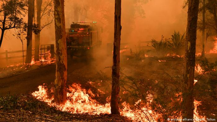 A wild fire burns near property in Australia