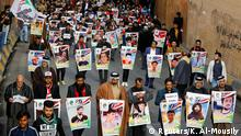 Iraqi demonstrators from Nassiriya city hold the pictures of people who were killed during ongoing anti-government protests in Baghdad, Iraq December 6, 2019. REUTERS/Khalid al-Mousily