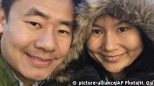 This Dec. 20, 2015, photo provided by Hua Qu, right, shows her Chinese-American husband Xiyue Wang, a Princeton University graduate student in history, posing for a photograph while visiting New York. Wang has been detained in Iran since August 2016. Families of several Americans currently detained in Iran are hoping President Donald Trump's decision announced on Tuesday, May 8, 2018, to withdraw from the Iran nuclear deal will not make it harder to get their love ones freed. (Hua Qu via AP) |