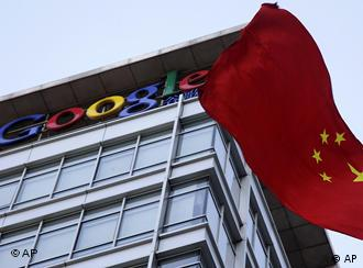 A Chinese flag flutters near the Google logo on top of Google's China headquarters in Beijing
