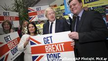 Home Secretary Priti Patel, center left, Britain's Prime Minister Boris Johnson, center, and MP Will Quince pose holding a sign before a rally event as part of the General Election campaign, in Colchester, England, Monday, Dec. 2, 2019. British Prime Minister Boris Johnson and main opposition Labour Party leader Jeremy Corbyn paused to honor the two people killed in the London Bridge attack, then went back to trading blame for the security failings that allowed a man who had been jailed for terrorist crimes to go on a violent rampage in the heart of London. (Hannah McKay/Pool Photo via AP) |
