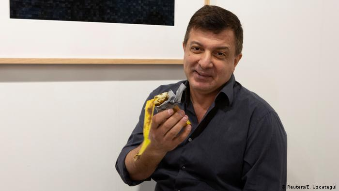Man eats $120,000 banana taped to wall at Miami art exhibition