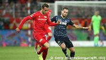 BERLIN, GERMANY - DECEMBER 08: Marcus Ingvartsen of 1. FC Union Berlin battles for possession with Birger Verstraete of 1. FC Koeln during the Bundesliga match between 1. FC Union Berlin and 1. FC Koeln at Stadion An der Alten Foersterei on December 08, 2019 in Berlin, Germany. (Photo by Maja Hitij/Bongarts/Getty Images)