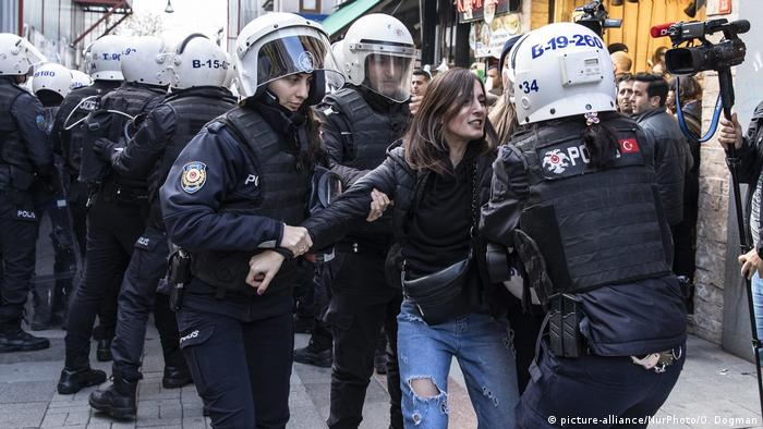 A woman is arrested at a protest in Istanbul