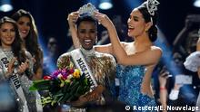 Zozibini Tunzi, of South Africa, is crowned Miss Universe by her predecessor, Catriona Gray of the Philippines, at the 2019 Miss Universe pageant at Tyler Perry Studios in Atlanta, Georgia, U.S. December 8, 2019. REUTERS/Elijah Nouvelage