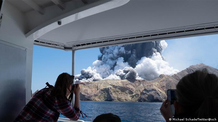 Tourist Michael Schade took this photo moments after leaving the island 'about a minute or two into the eruption'