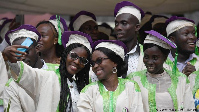 Students in gown and cap celebrate their graduation (Getty Images/AFP/I. Sanogo)