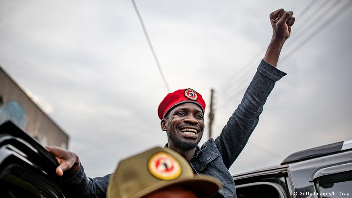 Ugandan lawmaker Bobi Wine holds up his fist (Getty Images/L. Dray)