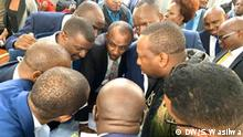 Nairobi Governor Mike Sonko consulting with his lawyers inside Milimani Law Courts. Sonko is facing corruption charges