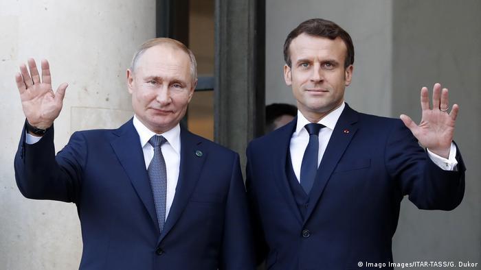 Президенти Росії Володимир Путін (л) та Франції Еммануель Макрон у Парижі 9 грудня