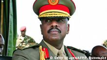 The son of Uganda's President Yoweri Museveni, Major General Muhoozi Kainerugaba attends a ceremony in which he was promoted from Brigadier to Major General at the country's military headquarters in Kampala on May 25, 2016. The son of Uganda's President Yoweri Museveni, one of Africa's longest-serving leaders, has rejected claims that he plans to succeed his father, reports said Thursday. Muhoozi Kainerugaba, speaking on May 25 after he was promoted from Brigadier to Major General, heading the Special Forces Command (SFC), said he was happy with being in the military, the government-owned New Vision newspaper reported. / AFP / PETER BUSOMOKE (Photo credit should read PETER BUSOMOKE/AFP via Getty Images)