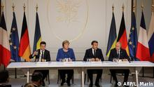(FromL) Ukrainian President Volodymyr Zelensky, German Chancellor Angela Merkel, French President Emmanuel Macron and Russian President Vladimir Putin give a press conference after a summit on Ukraine at the Elysee Palace, in Paris, on December 9, 2019. (Photo by ludovic MARIN / POOL / AFP)