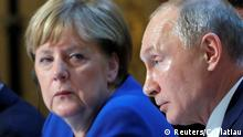 File photo taken in 2019 of German Chancellor Angela Merkel and Russia's President Vladimir Putin.