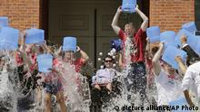 In this Aug. 10, 2015, photo, Massachusetts Gov. Charlie Baker, right center, and Lt. Gov. Karyn Polito, third from left, participate in the Ice Bucket Challenge with its inspiration Pete Frates, seated in center, to raise money for amyotrophic lateral sclerosis, or ALS, research at the Statehouse in Boston. Frates, whose challenge raised millions of dollars for research on Lou Gehrig's disease, is recovering from a health scare that landed him in the hospital. (AP Photo/Charles Krupa) |
