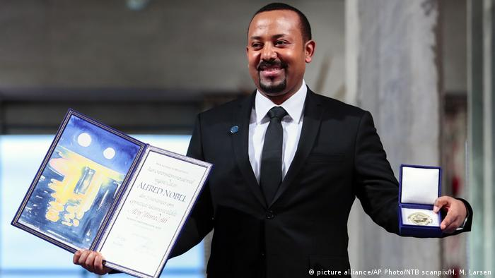 Ethiopia's Prime Minister Abiy Ahmed holds his Nobel Peace Prize