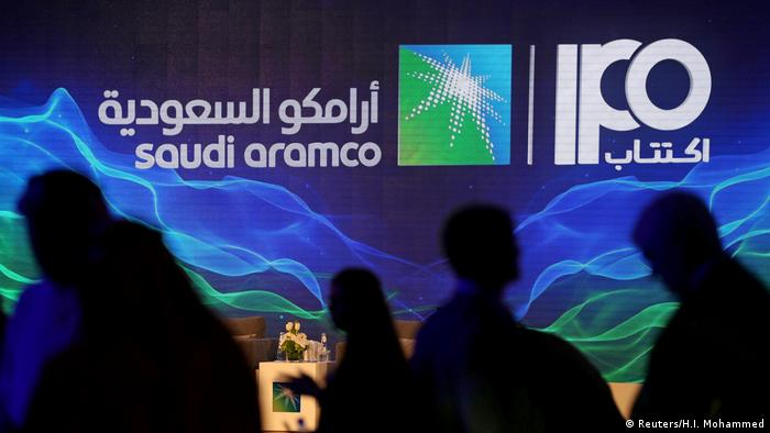 A sign of Saudi Aramco's initial public offering (IPO) is seen during a news conference by the state oil company at the Plaza Conference Center in Dhahran