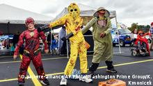 IMAGE DISTRIBUTED FOR WASHINGTON PRIME GROUP - At the Mall at Johnson City Boo 'N' Brew, l-r, Alijah Hensley, age 6, Andrew Hensley, age 11, and Isaac Laws, age 8 of Johnson City, perform the floss dance dressed in their Halloween costumes on Saturday, October 27, 2018 in Johnson City, Tennessee. (Kathy Kmonicek/AP Images for Washington Prime Group)  