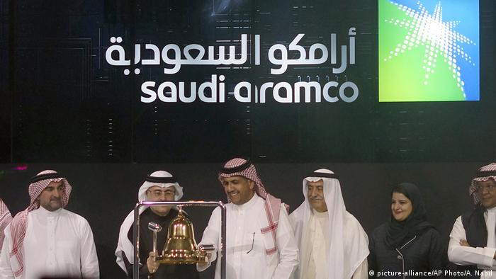 Officials ring the bell at the IPO opening for Saudi Aramco