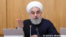 HANDOUT - 11.12.2019, Iran, Teheran: Hassan Rouhani, Präsident des Irans, spricht bei einer Sitzung des iranischen Kabinetts. Foto: -/Iranian Presidency/dpa - ACHTUNG: Nur zur redaktionellen Verwendung und nur mit vollständiger Nennung des vorstehenden Credits +++ dpa-Bildfunk +++   Verwendung weltweit
