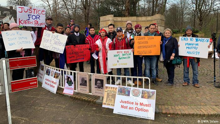Rohingya supporters stood outside the ICJ in the Hague with signs