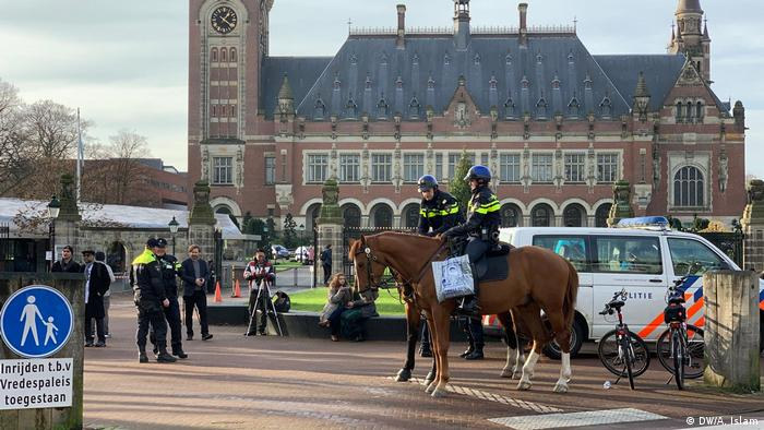 Police on horses stand guard outside the Hague court