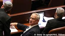 Israeli Kahol Lavan (Blue and White) political alliance leader Benny Gantz (C) looks on as he sits next to other alliance members during a session of the Knesset (Israeli parliament) in Jerusalem on December 11, 2019. - Israel's parliament was rushing through a bill to call a third general election in a year, prolonging a political crisis and fuelling deep dissatisfaction with politicians. A deal to avert a new vote must be reached before 11:59 pm (2159 GMT), but unity government talks between rightwing premier Benjamin Netanyahu and his centrist rival Benny Gantz broke down. The Knesset passed in the morning a preliminary reading of a bill to dissolve itself, setting a new election for March 2. (Photo by Gali TIBBON / AFP) (Photo by GALI TIBBON/AFP via Getty Images)