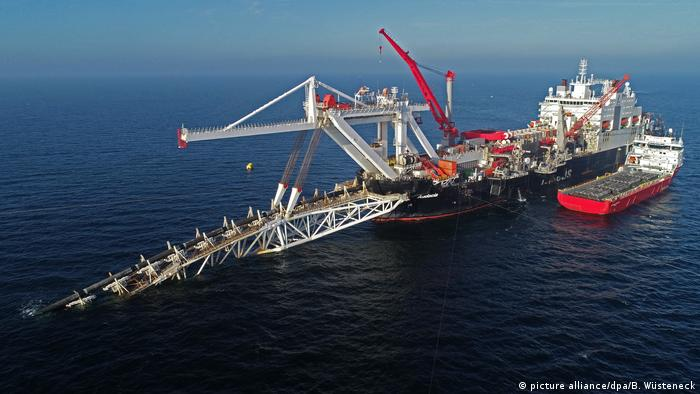 Aerial view of a ship that's installing pipes in the Baltic Sea