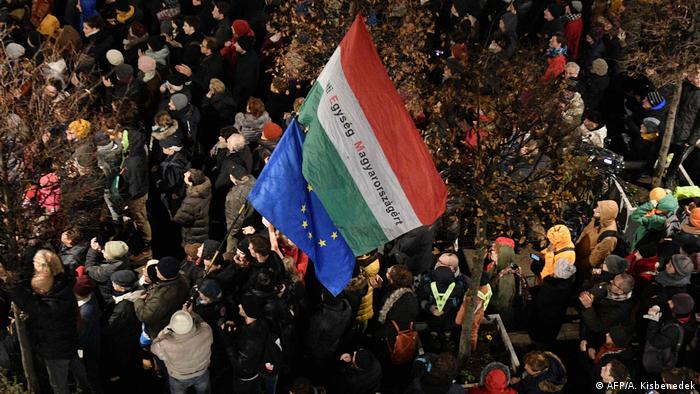 Orban opponents with Hungarian and European flags at a demonstration in December 2019