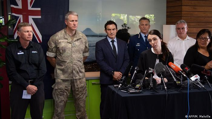 Prime Minister Jacinda Ardern before microphones at a news conference in Whakatane, New Zealand