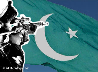 A Taliban fighter and the flag of Pakistan