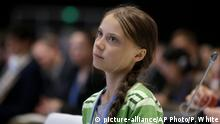 December 11, 2019*** FILE - In this Wednesday, Dec. 11, 2019 file photo Swedish climate activist Greta Thunberg listens to speeches before addressing a plenary of U.N. climate conference at the COP25 summit in Madrid, Spain. On Friday, Dec. 13, 2019, The Associated Press reported on a video circulating online, with some posts incorrectly asserting it shows Thunberg firing an AR-15 rifle. The shooter in the video is another young Swede named Emmy Slinge, who uploaded the original video to her Twitter account. (AP Photo/Paul White)
