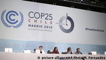 Chilean Environment Minister and chair of COP25 Carolina Schmidt, sitting 2nd left, take part at the COP25 climate talks congress in Madrid, Spain, Saturday, Dec. 14, 2019. The United Nations Secretary-General has warned that failure to tackle global warming could result in economic disaster. (AP Photo/Manu Fernandez) |