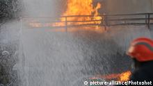 (090504) -- DHAKA, May 4, 2009 -- An oil tanker truck is burnt in Dhaka, capital of Bangladesh, on May 4, 2009. At least seven cars and some 9000 liters of octane were burnt in this fire. (Qamruzzaman) (xxd) |