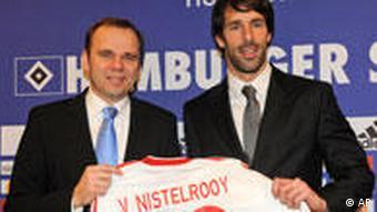 Dutch forward Ruud van Nistelrooy, right, and Bernd Hoffmann