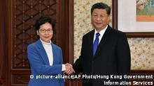 16.12.2019 *** In this photo provided by Hong Kong Government Information ServicesChinese President Xi Jinping, right, shakes hands with Hong Kong Chief Executive Carrie Lam in Beijing, China, Monday, Dec. 16, 2019. Chinese President Xi Jinping has said Hong Kong has faced its grimmest and most complex year since the former British colony was returned to China, before reiterating his support for the semi-autonomous city's leader. (Hong Kong Government Information Services via AP) |