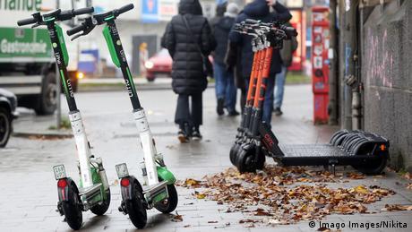 E-scooters waiting on the sidewalk in Hamburg