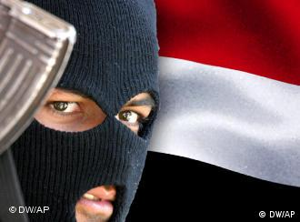 Masked terrorist in front of the Yemen flag