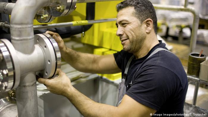 A man works in a factory in Berlin, Germany