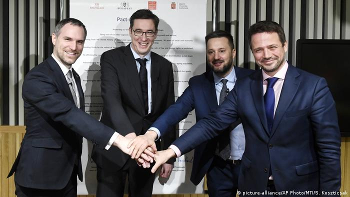 The mayors of Prague, Budapest, Bratislava and Warsaw pose for a photo