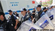 Police officers get ready to stop members and supporters of the Confederation of Public Employees Trade Unions (KESK) from marching in protest to the ministry of Labour during a protest demanding better working conditions, in Ankara on May 24, 2019. (Photo by Adem ALTAN / AFP) (Photo credit should read ADEM ALTAN/AFP via Getty Images)