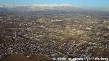 Aerial view of the capital of Tajikistan Dushanbe taken 28 January 2002 from a C-130 Hercule, during a mission accomplished by the French Air Force. AFP PHOTO ERIC FEFERBERG (Photo credit should read ERIC FEFERBERG/AFP via Getty Images)