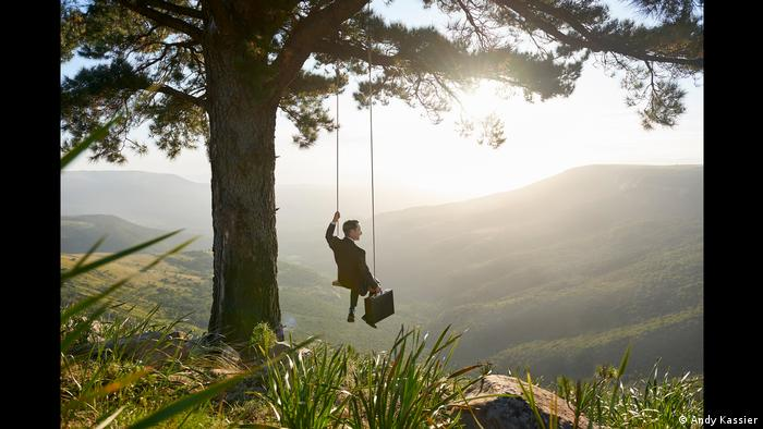Andy Kassier, Just Swinging, a man with a briefcase swinging on a swing from a tree (Andy Kassier)