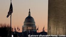 The U.S. Capitol building, center, and part of the Washington Monument, right, are seen at sunrise, Wednesday, Dec. 18, 2019, on Capitol Hill in Washington. President Donald Trump is on the cusp of being impeached by the House, with a historic debate set Wednesday on charges that he abused his power and obstructed Congress ahead of votes that will leave a defining mark on his tenure at the White House. (AP Photo/Julio Cortez) |