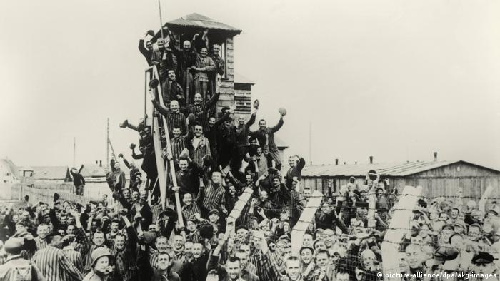 Prisoners rejoicing following the liberation of the concentration camp on April 29, 1945
