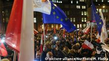 People with Polish and EU flags protesting in front of Court are seen in Gdansk, Poland on 18 December 2019People gathered in over 180 Polish cities to protest against a proposal by the ruling Law and Justice nationalists party, that would allow for judges to be punished and even fired if they question the legitimacy of the government'Äôs judicial reforms and , if they will apply European Union laws. (Photo by Michal Fludra/NurPhoto) | Keine Weitergabe an Wiederverkäufer.