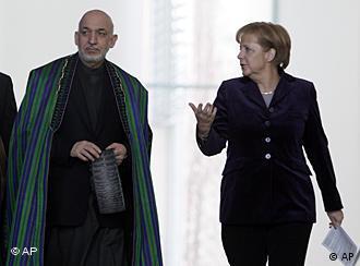 Afghan President Hamid Karzai and German Chancellor Angela Merkel